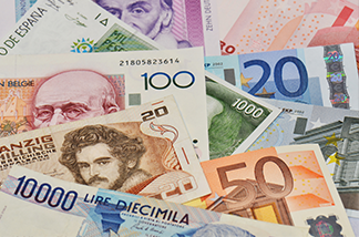 stock-photo-former-european-national-currencies-and-new-european-currency-euro-137695073
